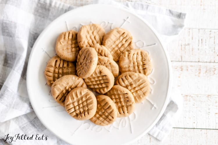 keto no bake peanut butter cookies arranged on round white plate