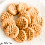 Pile of no bake peanut butter cookies on a round, white plate