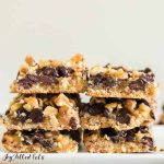 two stacks of magic cookie bars on white plate