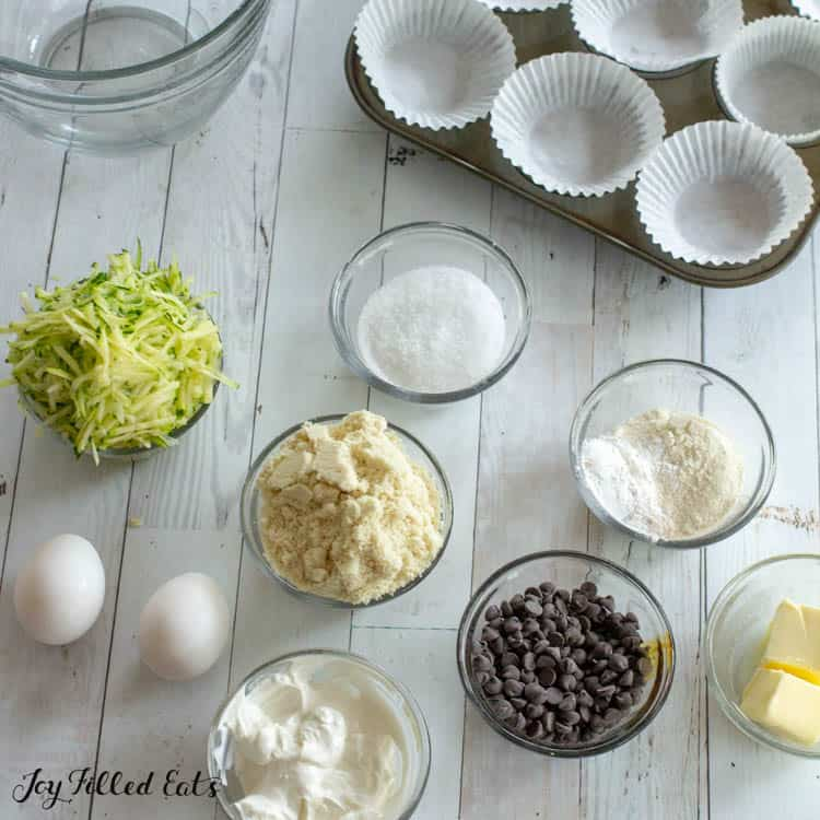 ingredients for the Chocolate Chip Zucchini Muffins in small glass bowls