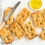 keto garlic bread portions with herb butter and butter knife