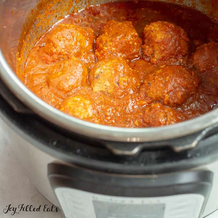 overhead view of meatballs and sauce cooking within the instant pot