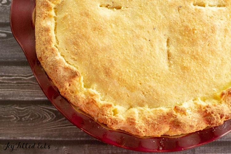 overhead view of turkey pot pie in red casserole pie dish