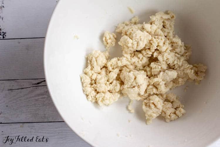 large white mixing bowl of dough