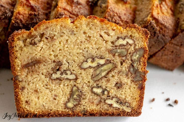 close up of keto banana bread slice exposing nuts within bread