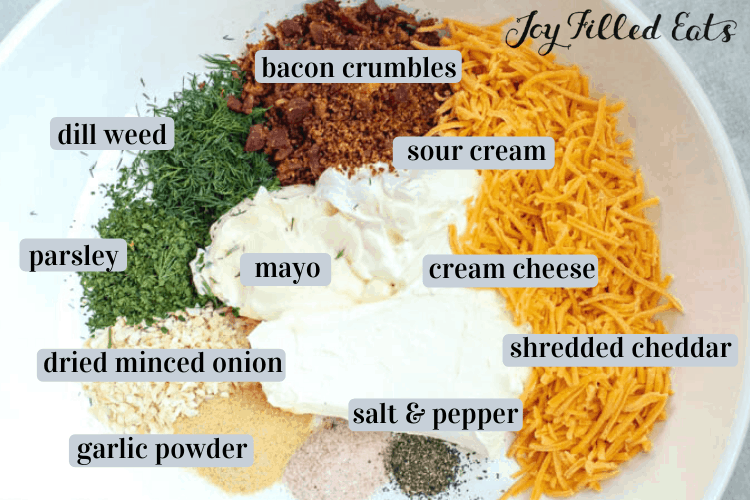 Chicken Bacon Ranch Casserole ingredients including bacon crumbles, sour cream, dill weed, cream cheese, mayo, parsley, shedded cheddar, dried minced onion, garlic powder, salt and pepper