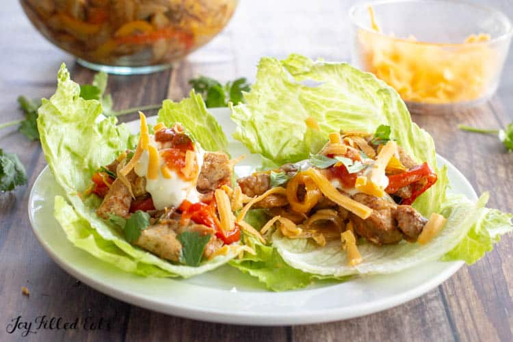 Lettuce leafs with Baked Chicken Fajita filling, topped with sour cream and shredded cheese