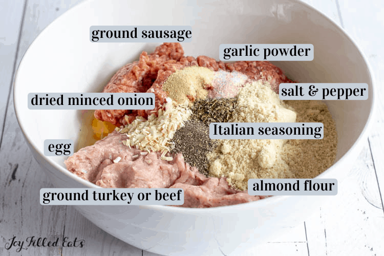 Mozzarella stuffed meatball ingredients including ground sausage, dried minced onion, garlic powder, salt and pepper, italian seasoning, egg, ground turkey or beef, almond flour