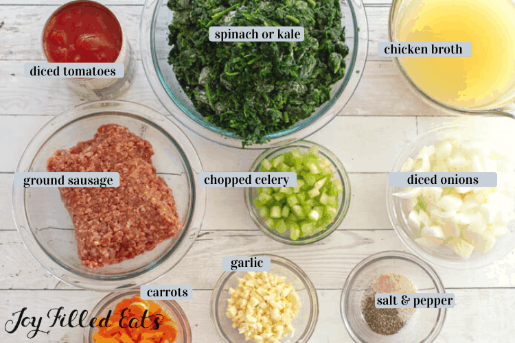 Ingredients in various bowls. Includes diced tomatoes, spinach or kale, chicken broth, ground sausage, chopped celery, diced onion, carrots, garlic, salt and pepper