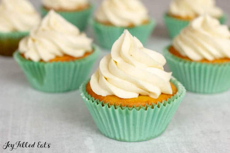 Almond Flour Cupcakes topped with buttercream frosting in light blue cupcake wrappers