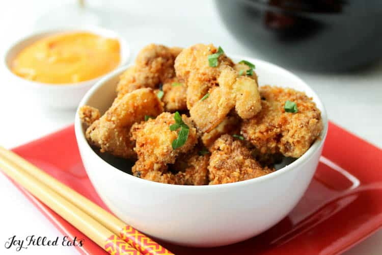 a bowl of keto fried cauliflower with sweet chili sauce