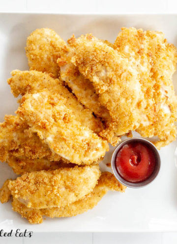 a square plate of chicken tenders