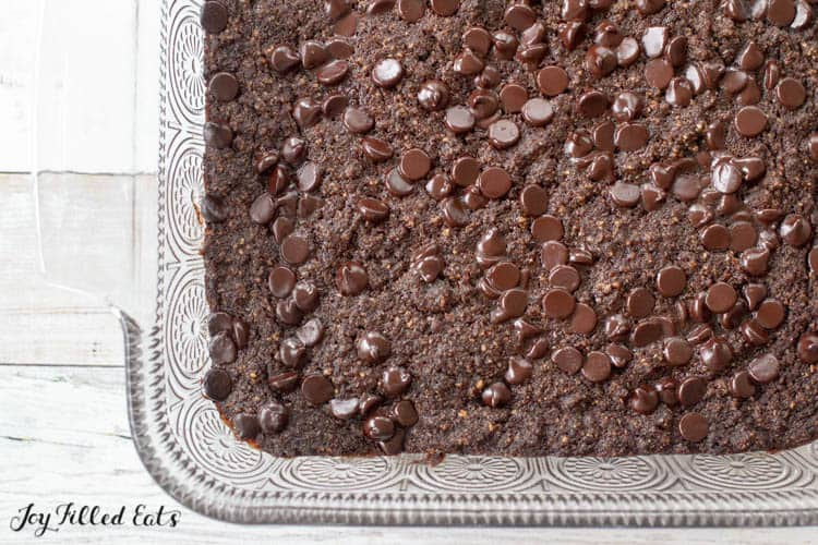 Overhead shot of glass casserole dish with low carb brownies uncut