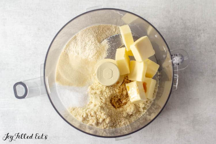 Crust for Keto Cheesecake bar ingredients include almond flour, coconut flour, sweetener, softened butter, softened cream cheese, and vanilla