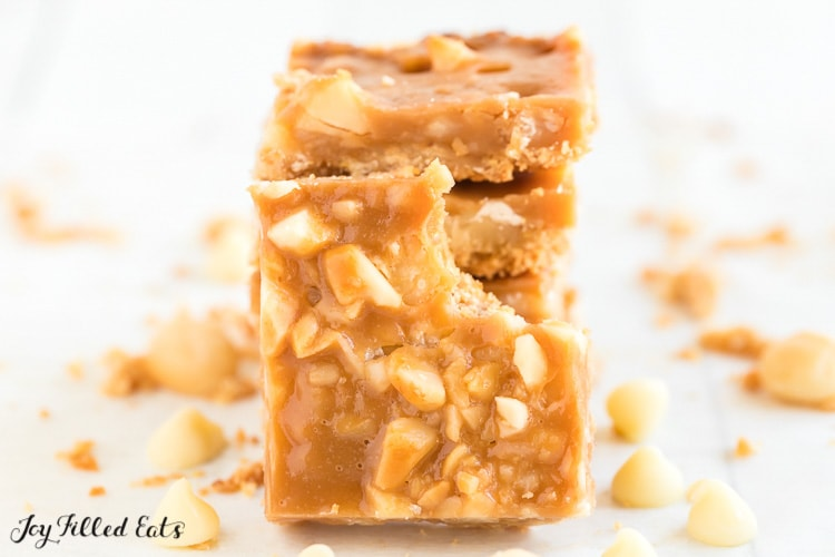 one of the caramel magic cookie bars with a bite missing