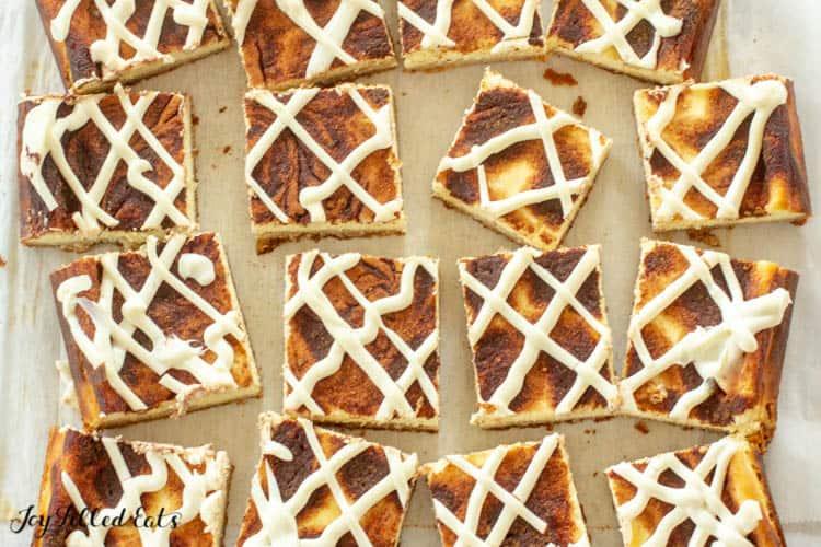 overhead shot of square cinnamon bun cheesecake bar slices