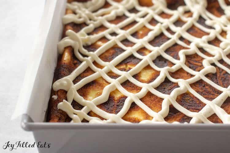 Cinnamon Bun Cheesecake bars in baking pan uncut