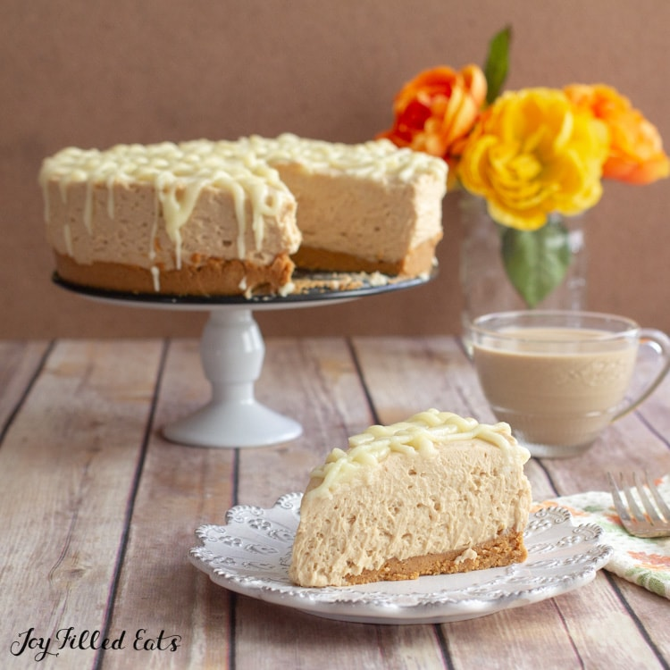 cake stand with peanut butter cheesecake on it and a slice on a plate