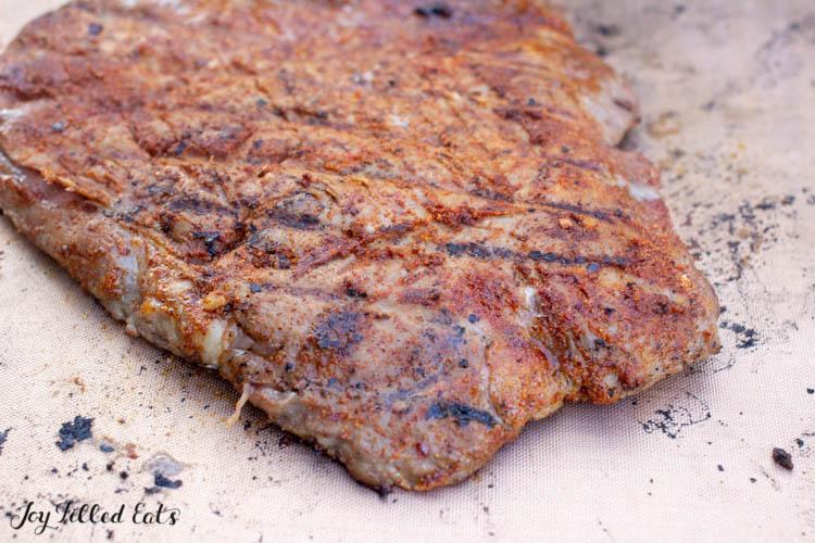 a grilled steak on a cutting board