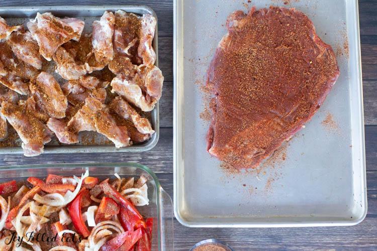 fajita spices on steak, chicken, and veggies