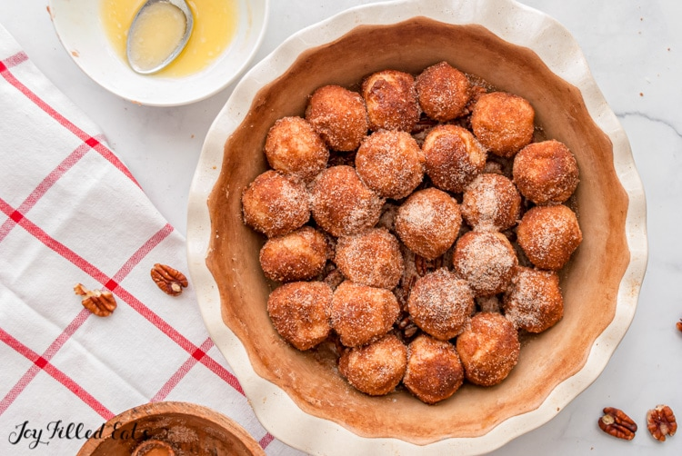 cinnamon coated balls of dough in a pie plate