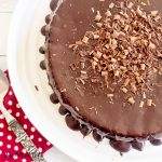 overhead view of chocolate cake with chocolate frosting topped with chocolate shavings