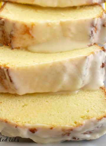 glazed lemon pound cake slices fanned out on a plate close up