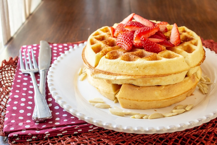 A big stack of Low Carb Waffles on a white plate.