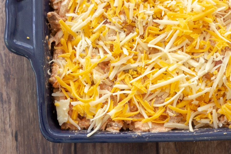 baking dish before baking topped with shredded cheese from above