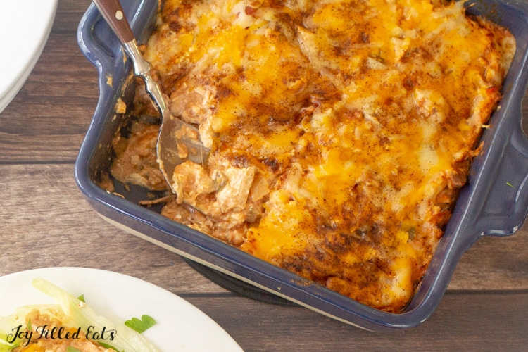 casserole dish of Mexican chicken casserole with a spoon from overhead