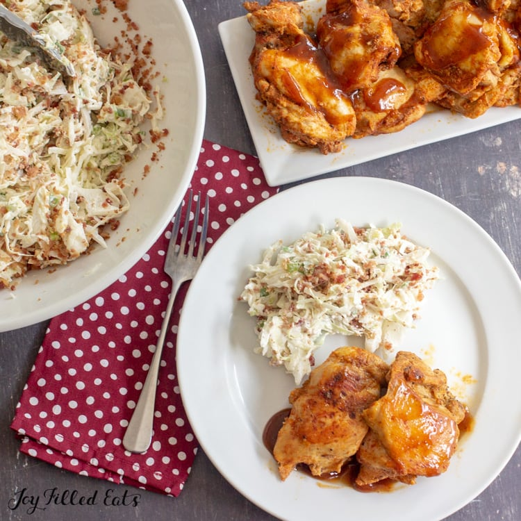 Chicken from the BBQ Chicken Instant Pot Recipe on a plate with keto coleslaw