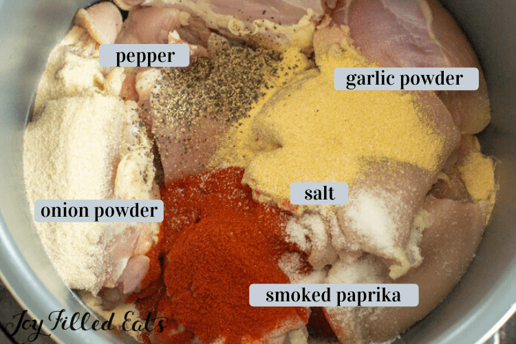 chicken thighs and spices in the instant pot bowl