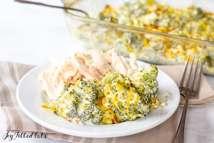 keto broccoli casserole on a plate with chicken