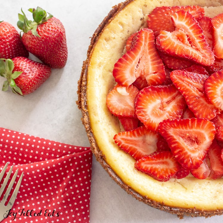 cheesecake topped with sliced strawberries