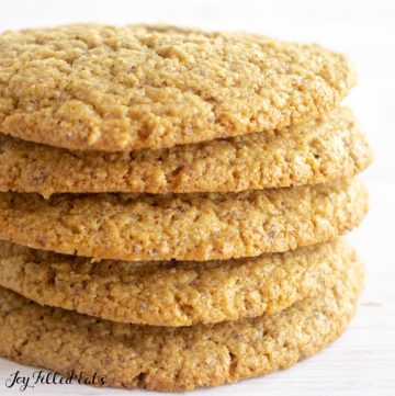 five almond flour peanut butter cookies stacked on top of each other