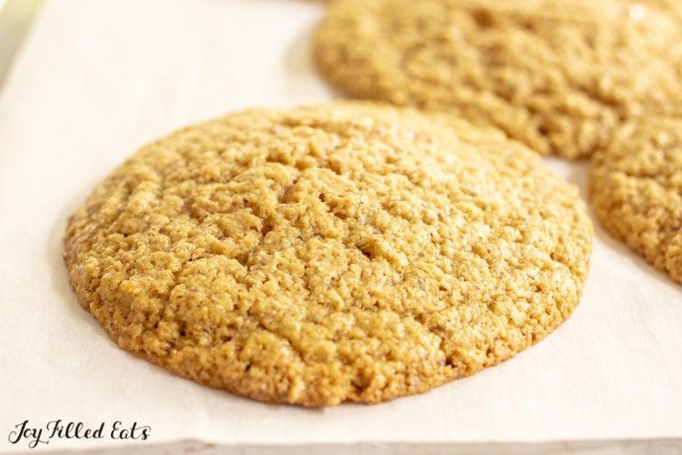 close up of one of the almond flour peanut butter cookies on a baking sheet