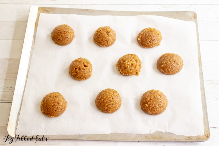 cookies on a parchment lined baking sheet