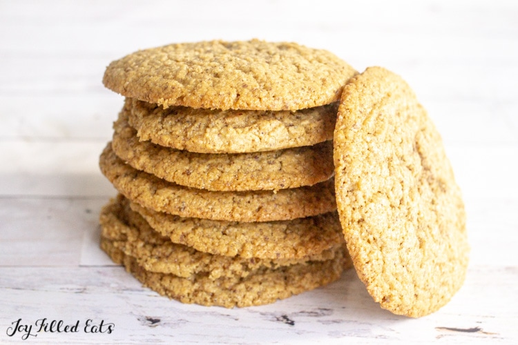 stack of 6 cookies with one next to it on its edge