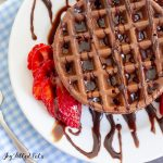 overhead shot of a chocolate chaffle drizzled with syrup