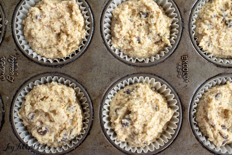 batter in paper lined muffin tins