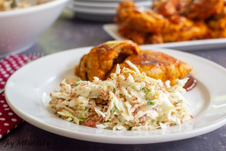 a plate with barbecue chicken and slaw