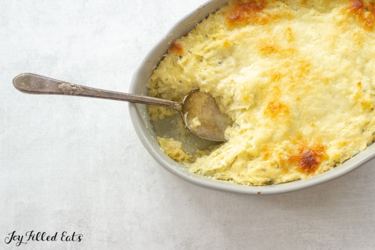 a casserole dish of baked spaghetti squash casserole with cheese