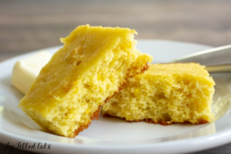 cornbread on a plate with a pat of butter