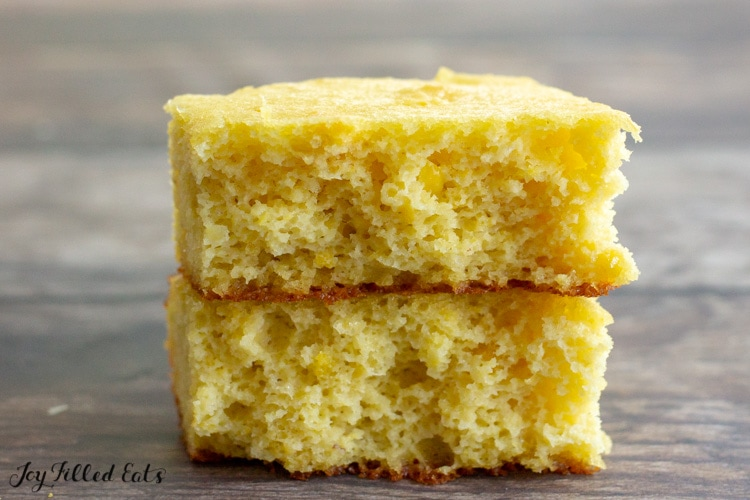 piece of low carb almond flour cornbread broken in half and stacked on top of each other
