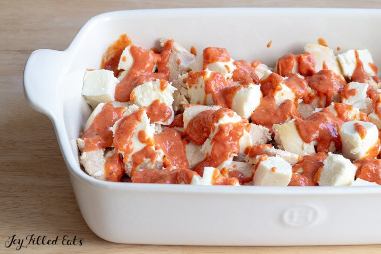 large white casserole dish with chicken and vodka sauce