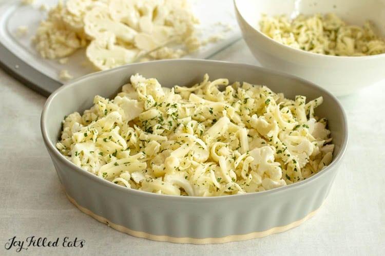 layering the keto cauliflower au gratin