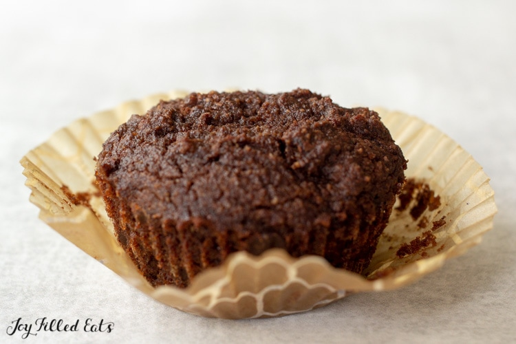 a muffin on top of the paper liner it was baked in