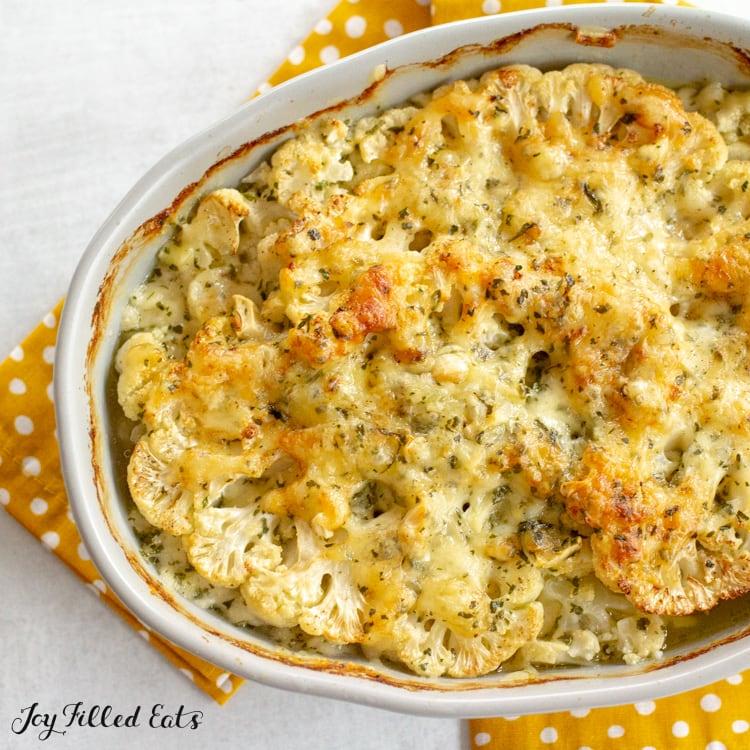 square overhead shot of a casserole dish with keto cauliflower au gratin