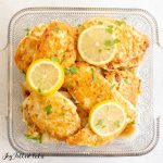 keto chicken piccatta in a square glass dish with lemon slices and parsley