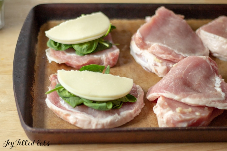 thin sliced pork chops layered with spinach and provolone